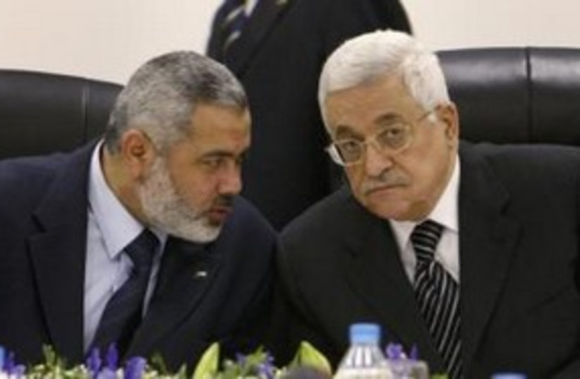 PA President Abbas with Hamas PM Haniyeh 311 (R) (photo credit: REUTERS/Suhaib Salem)