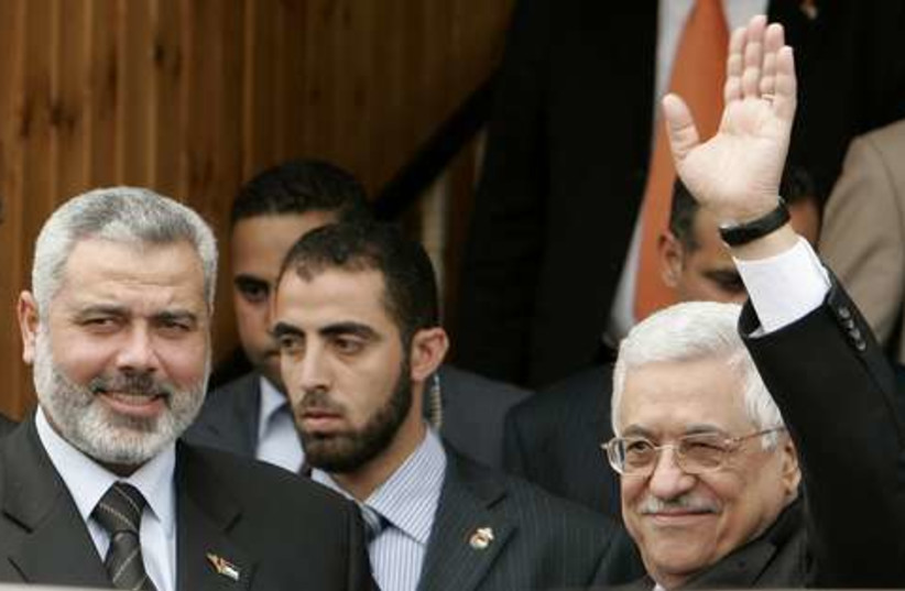 Haniyeh  and Abbas waving 521 (photo credit: REUTERS)