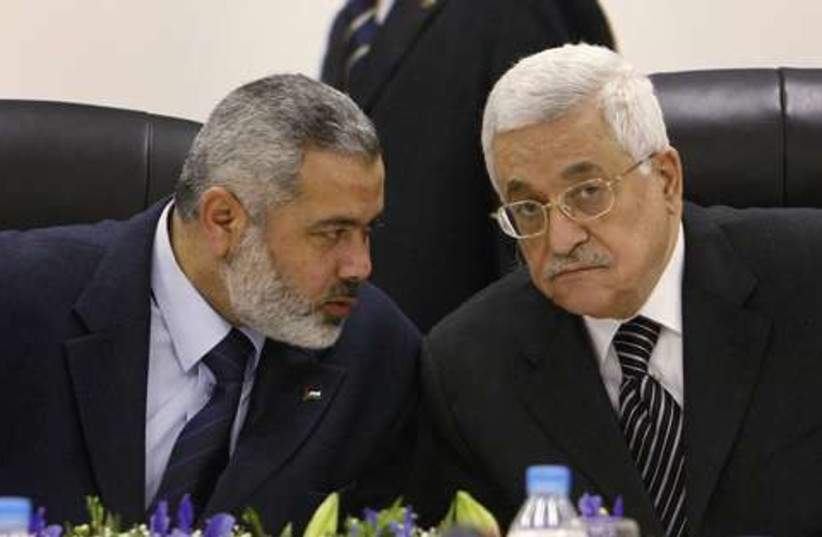 Haniyeh  and Abbas 521 (photo credit: REUTERS)