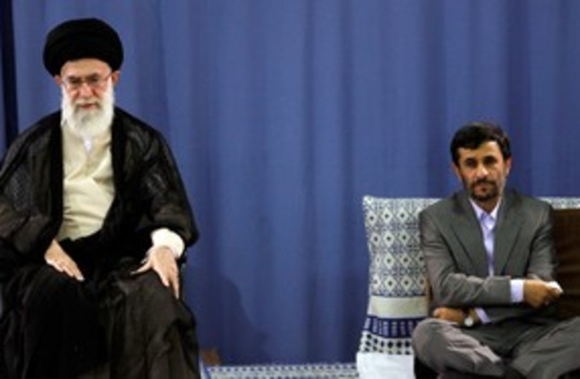 Iranian Supreme Leader Khamenei and Ahmadinejad 311 (R) (photo credit: Reuters)