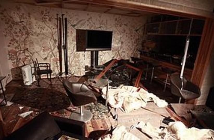gaddafi home damage 311 (photo credit: REUTERS)