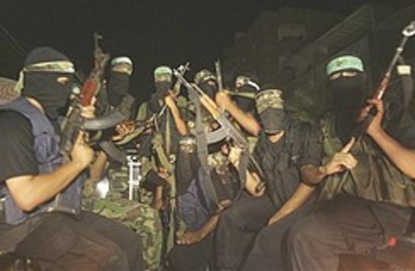 Hamas gunmen at a march in Rafah (photo credit: AP)