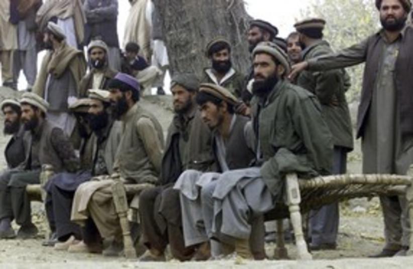 Captured Afghan al Qaeda members 311 R (photo credit: Reuters [file])