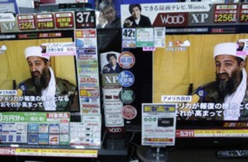 Bin Laden TV screens 311 R (photo credit: Reuters)