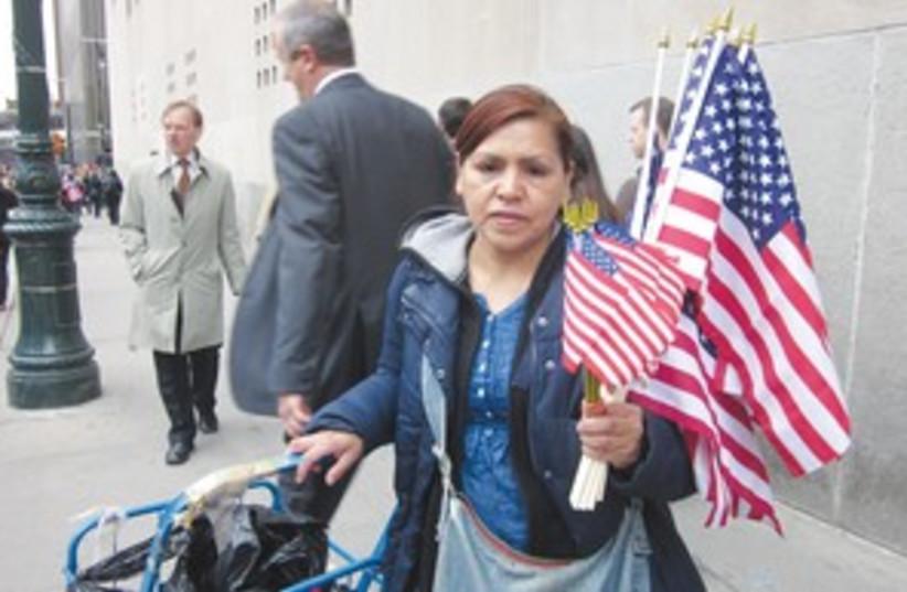woman holds US flags_311 (photo credit: JORDANA HORN)