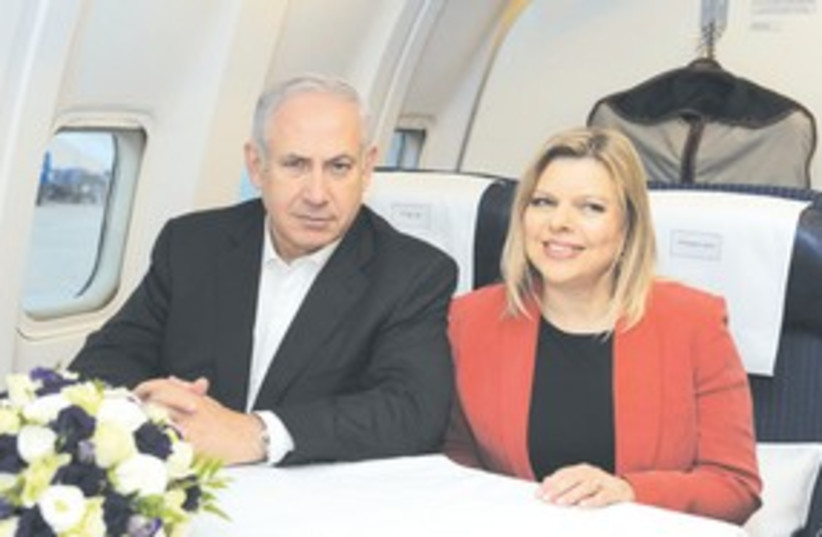 PM Netanyahu and wife Sarah headed to London 311 (photo credit: Amos Ben-Gershom/GPO)