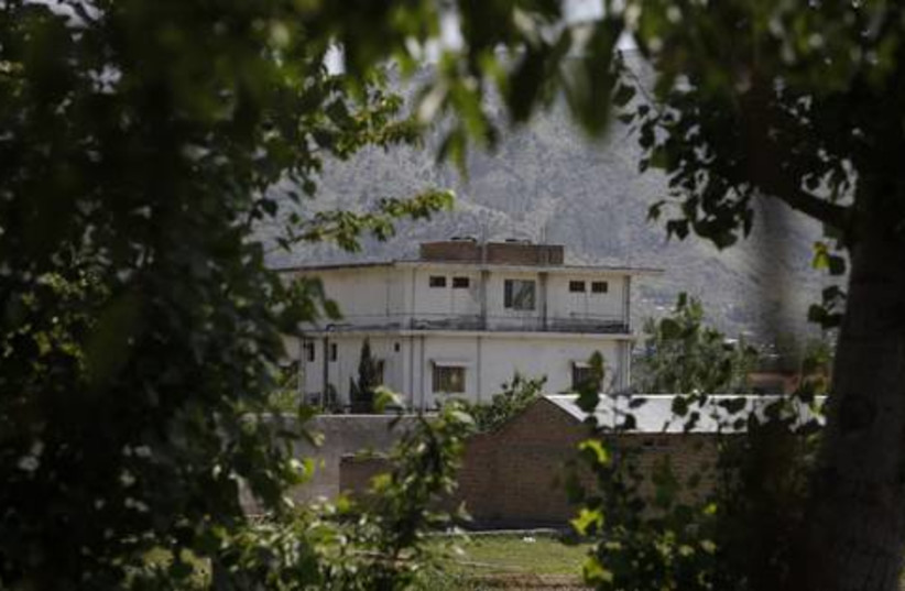 Bin Laden compound and trees 521 (photo credit: REUTERS/Akhtar Soomro)