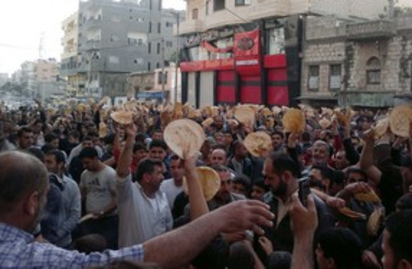 Syria bread protest Banias 311 R (photo credit: Reuters)
