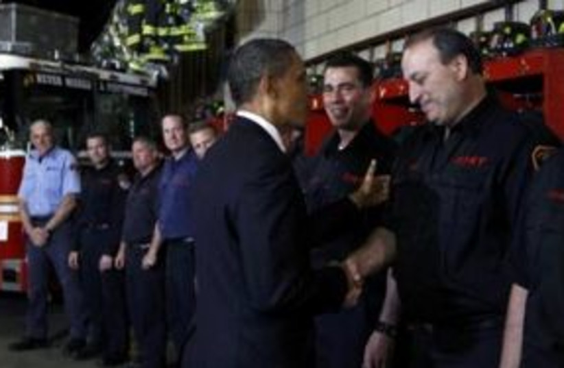 US President Barack Obama at NY firehouse 311 (R) (photo credit: REUTERS/Kevin Lamarque)