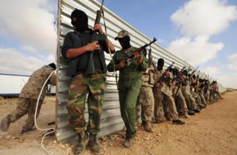 Libyan rebels with guns 311 (r) (photo credit: REUTERS/Esam al-Fetori)