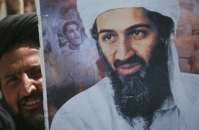 Man holds poster of Osama bin Laden at rally in Pakistan 311 (photo credit: REUTERS/Naseer Ahmed)