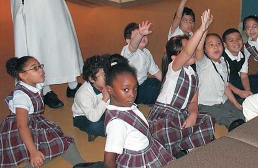 students raising hands 521 (photo credit: Maltz museum of Jewish heritage)