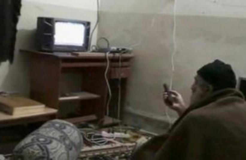 Bin Laden watches TV 311 (photo credit: REUTERS)