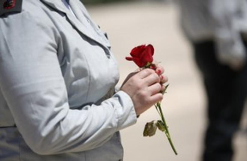 soldier with rose (photo credit: NIR ELIAS / Reuters)