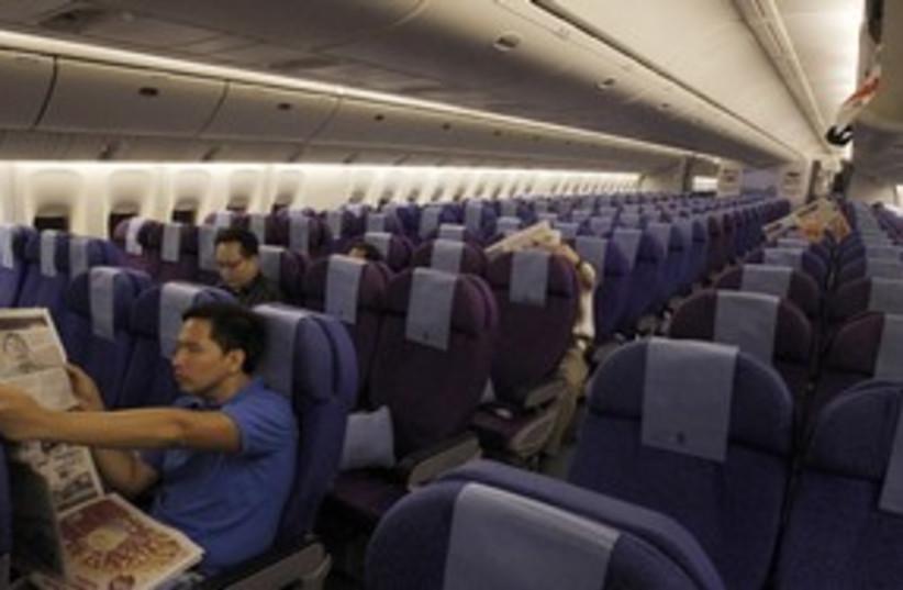 Passengers plane flight 311 (R) (photo credit: Vivek Prakash / Reuters)