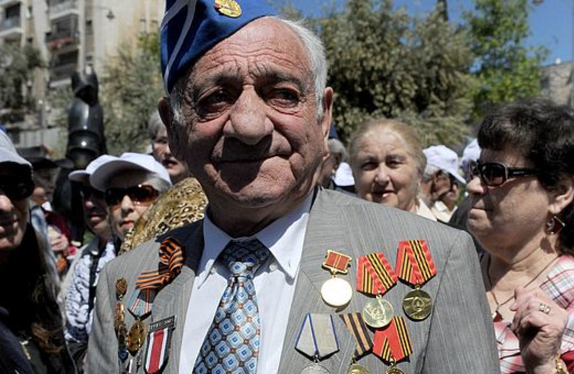 A World War II Veteran marches on VE Day