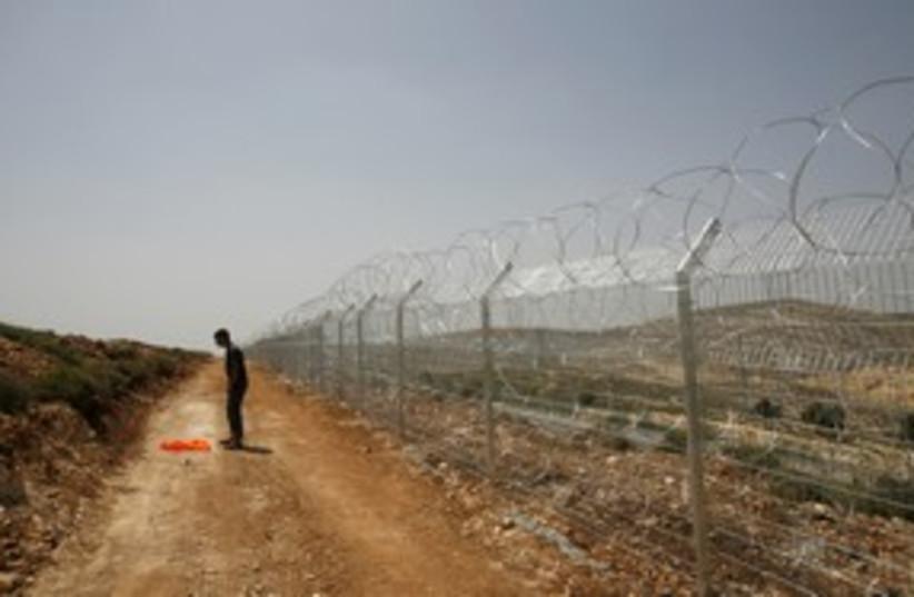 Security fence near Givat Ze'ev 311 (R) (photo credit: REUTERS/Ronen Zvulun)