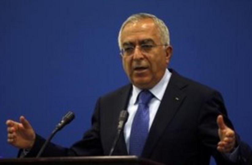 Palestinian Authority Prime Minister Salam Fayyad 311 (R) (photo credit: REUTERS/Mohamad Torokman)
