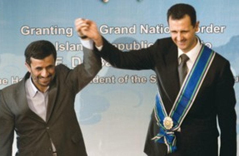 Ahmadinejad Assad 311 (photo credit: REUTERS)