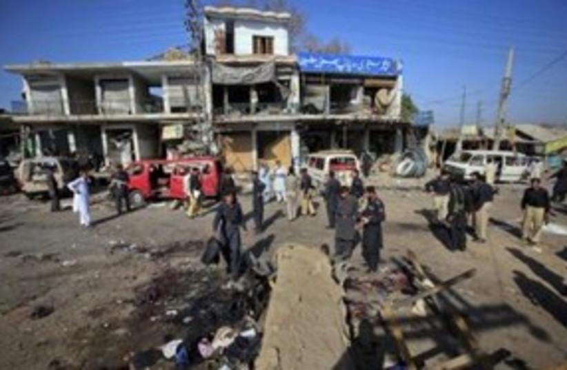 site of pakistan suicide bombing_311 reuters (photo credit: REUTERS/Fayaz Aziz )