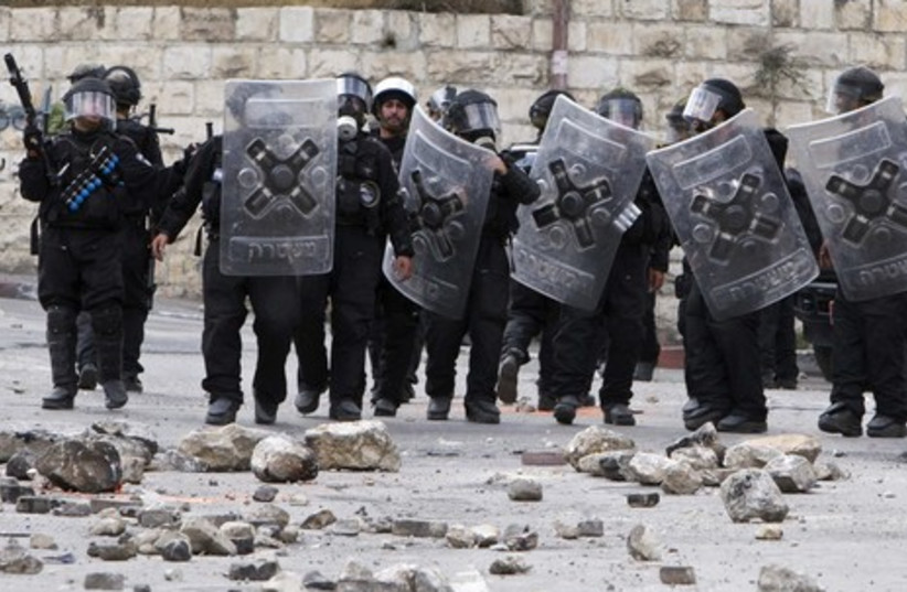 Police officers during clashes in Silwan