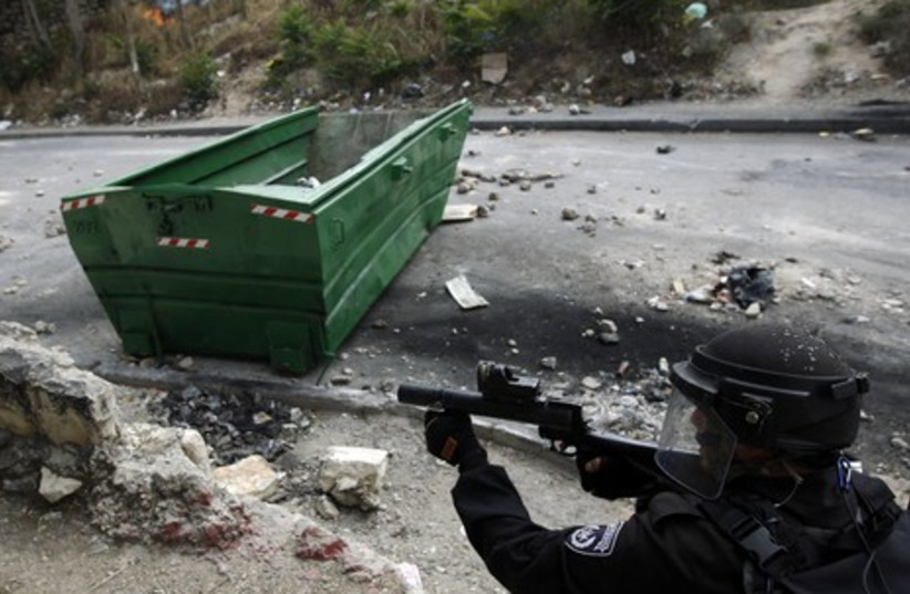 Police officers firing projectiles in Silwan clash