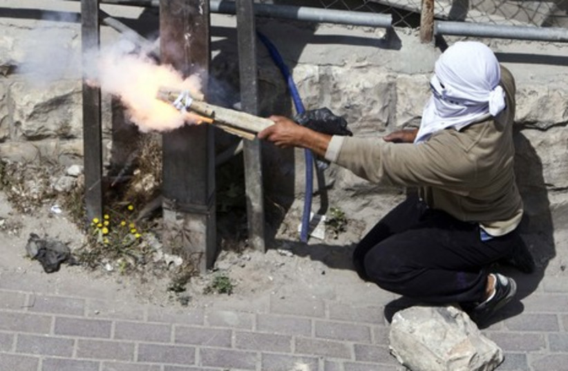 Palestinians firing homemade weapon in Silwan