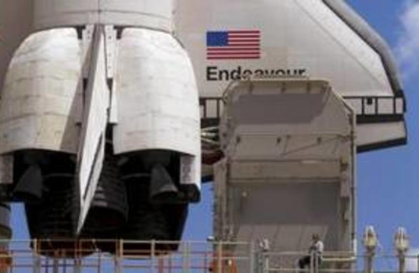 US Space Shuttle Endeavor 311 (R) (photo credit: REUTERS/Scott Audette)