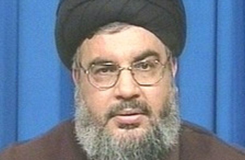 Nasrallah at mike 224.88 (photo credit: Channel 1 [file])
