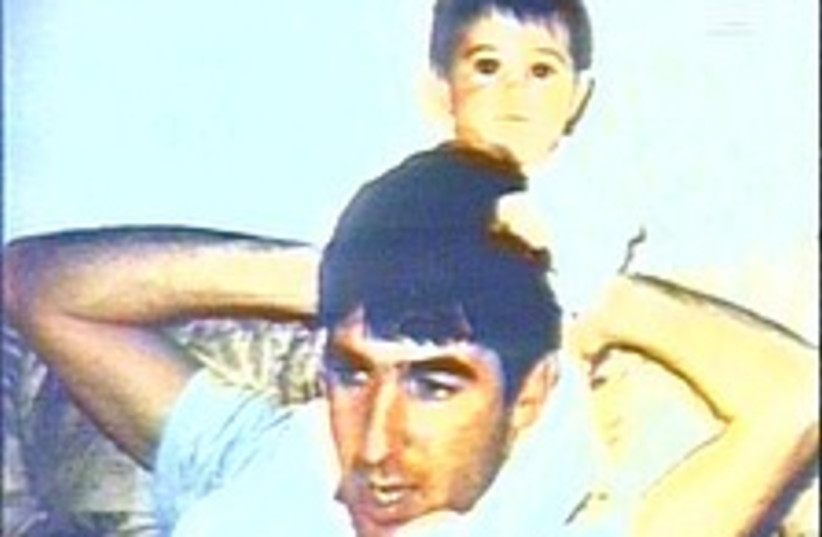 Ron arad with baby 224.8 (photo credit: Channel 10)