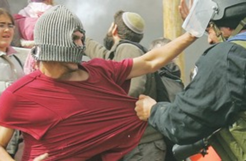 Israeli police scuffle with settlers_311 (photo credit: Reuters)
