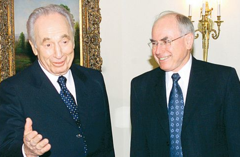 Peres and Howard 521 (photo credit: REUTERS)