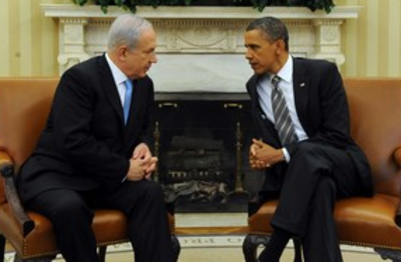 PM Netanyahu sitting with US President Obama 311 (photo credit: Avi Ohayon / GPO)
