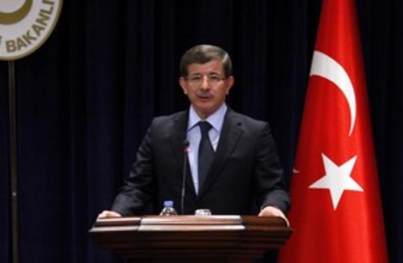 Turkish Foreign Minister Ahmet Davutoglu 311 (R) (photo credit: REUTERS/Umit Bektas)