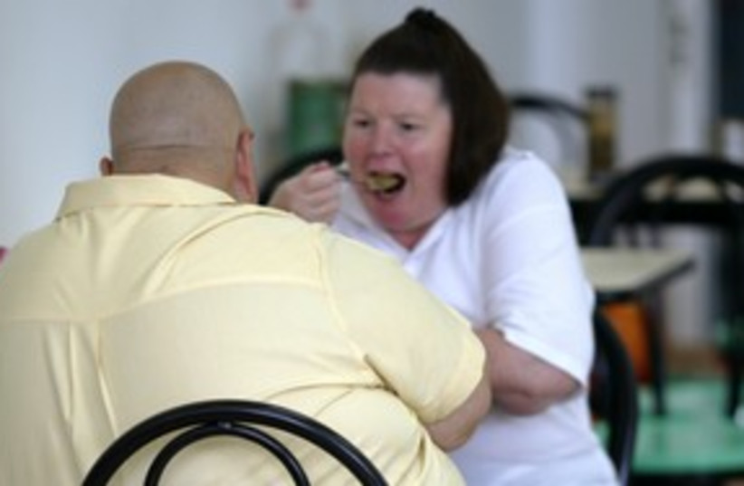 obese people large fat 311 (R) (photo credit: Reuters)