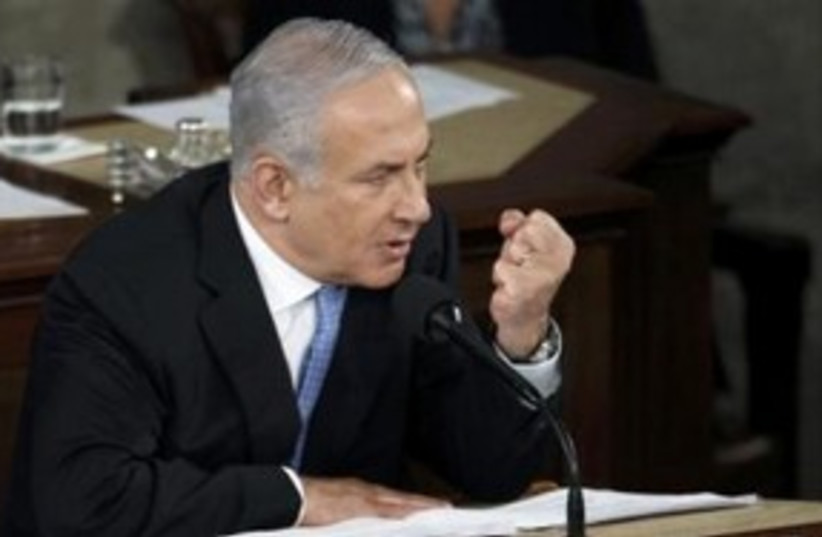 PM Netanyahu addresses Congress fist 311 (R) (photo credit: REUTERS/Molly Riley)