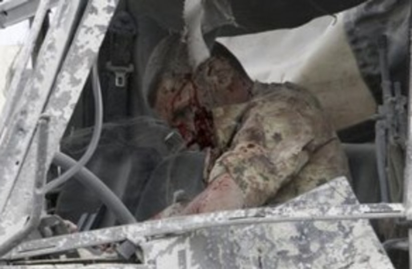 Injured UNIFIL soldier 311 (r) (photo credit: REUTERS/ Sharif Karim)