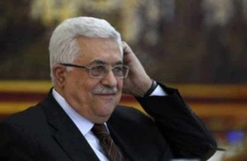 Abbas scratching his head 311 (r) (photo credit: REUTERS/Mohamad Torokman)