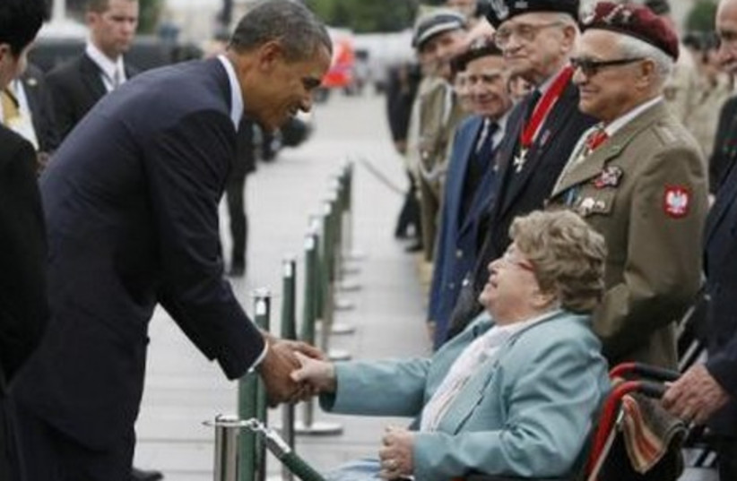 Obama meets Holocaust survivors in Warsaw