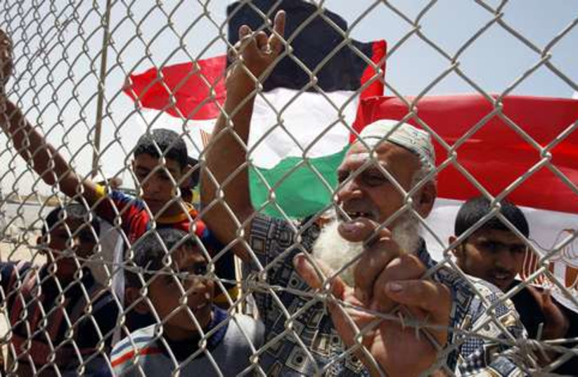 Palestinian rally at Rafah crossing 521 (photo credit: 	 REUTERS/Ibraheem Abu Mustafa)