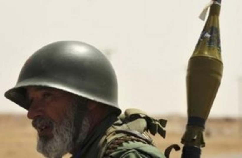 Libyan rebel with RPG 311 (R) (photo credit: REUTERS/Esam al-Fetori)