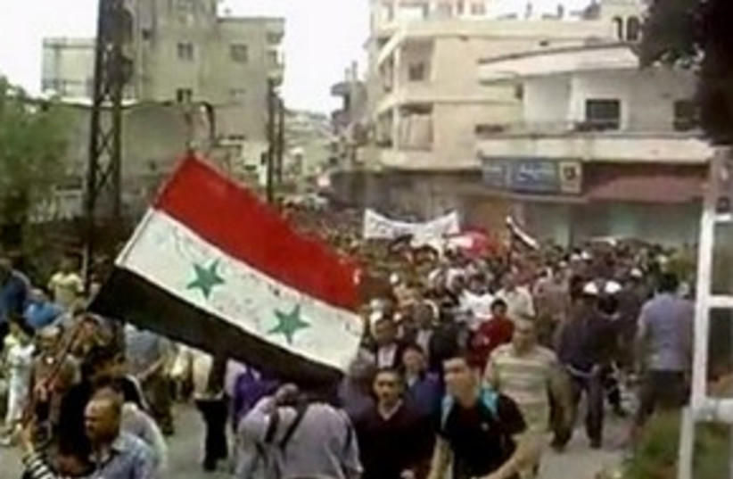 Syria Protest Homs 311 (photo credit: Reuters)