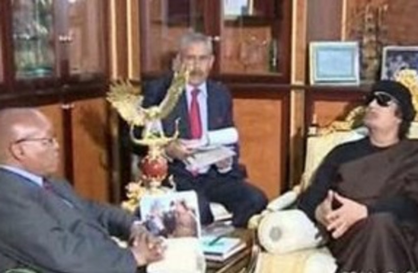 zuma and gaddafi_311 reuters (photo credit: REUTERS/ Libya TV via Reuters TV)
