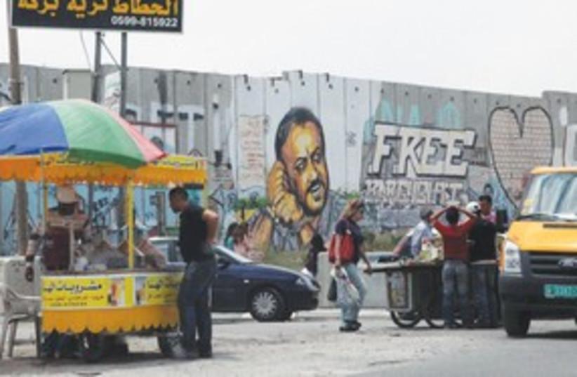 E. Jerusalem security barrier at Kalandiya 311 (photo credit: Marc Sellem Israel/The Jerusalem Post)
