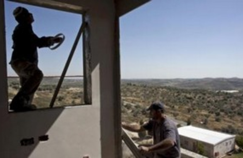 Palestinian workers build settlement home in Kedumim 311 (R) (photo credit: REUTERS/Nir Elias)