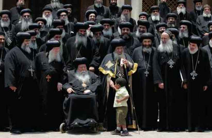 Egyptian Copts. Pope Shenouda (center).   (photo credit: ASMAA WAGUIH / REUTERS)