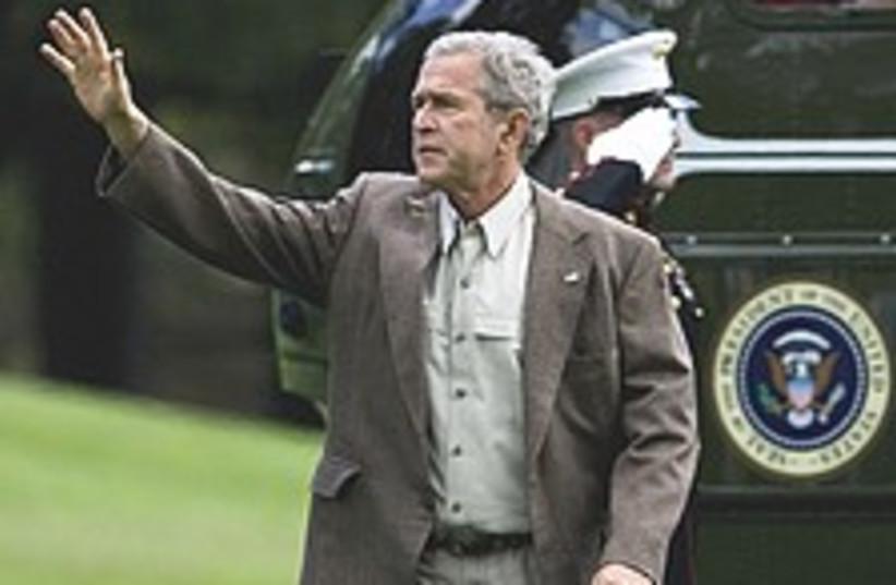 Bush waves 224.88 (photo credit: AP)