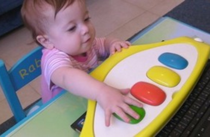 Baby with keyboard 311 (photo credit: Courtesy)