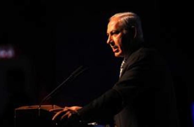 Prime Minister Binyamin Netanyahu dark 311 (R) (photo credit: Avi Ohayon / GPO)