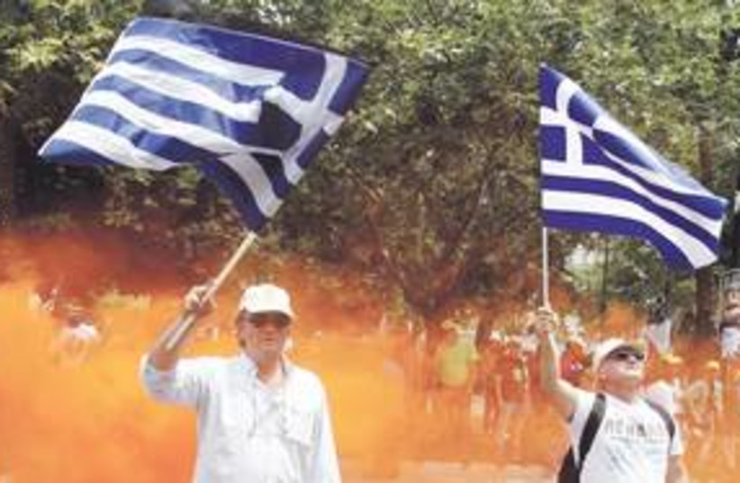 Greece protesters flags 311 (R) (photo credit: Yiorgos Karahalis/Reuters)